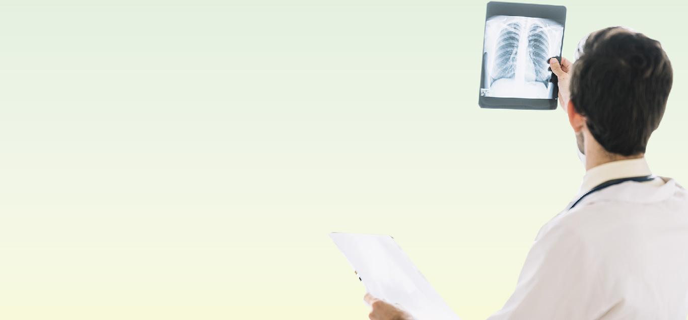 Pulmonologist Checks X-Ray Report
